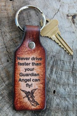 "Key Chain Tooled Leather ""Never Drive Faster than your Guardian Angel Can Fly"""