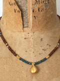 Alicia Van Fleteren necklace in hessonite garnet  and blue topaz semi precious stones with gold findings