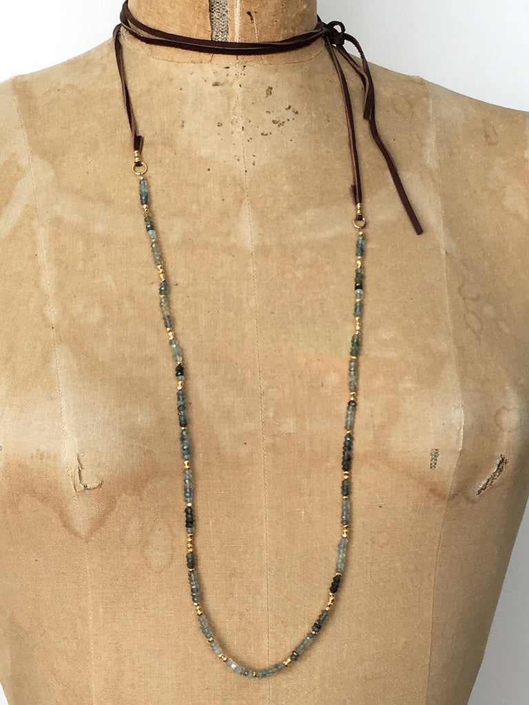 Alicia Van Fleteren necklace has aquamarine, moss quartz, pyrite and gold vermeil findings attached to brown leather ties.