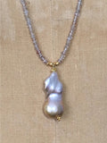 Close up of Alicia Van Fleteren necklace with a champagne pearl, champagne quartz, zircon and gold vermeil findings