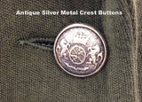 Detail of the antique silver crested button in Atelier Francesca jacket.