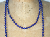 Close up of Lil Jewellry, faceted crystal necklace in blue