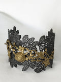 Bracelet by Lotta, leaf pattern in antiques bronze with floral motifs in 14K gold and labradorite accent