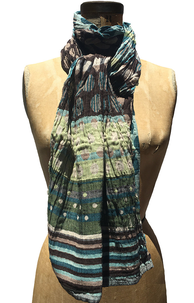 The Letol Colleen scarf has dot and stripe motifs in browns, turquoise and celery green.