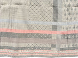 Detail of the Letol scarf, Daphne in warm grey, greys with soft coral.