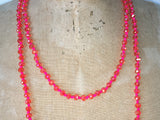 Close up of Lil Jewellry, faceted crystal necklace in hot pink