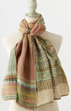 Letol scarf with stunning geo & floral pattern scarf, pistachio & sunny terra cottas.