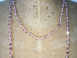 Close up of Lil Jewellry, faceted crystal necklace in pink & clear crystal
