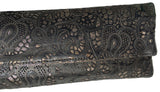 Detail of Louise Farnay laser cut leather clutch in black & bronze