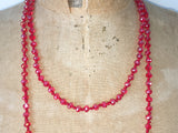 Close up of Lil Jewellry, faceted crystal necklace in red