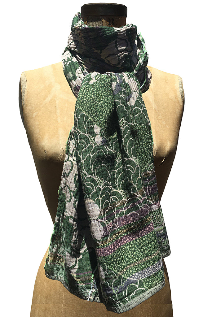 The Letol Samantha scarf has lush floral motifs in dark greens, warm grey and highlights of grape.