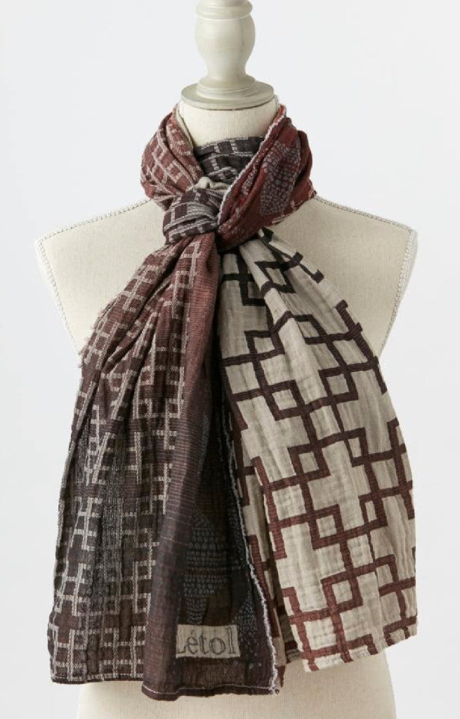 Sophisticated, strong geo pattern in black, rust, wine, warm grey.