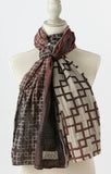 Letol scarf in sophisticated, strong geo pattern in black, rust, wine, warm grey.