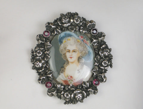Hand-painted miniature in ornate silver frame
