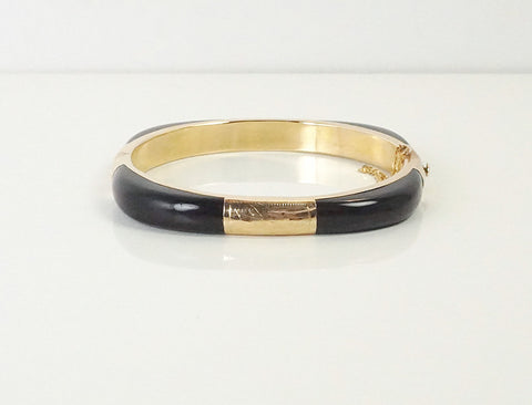Hinged bangle of black onyx