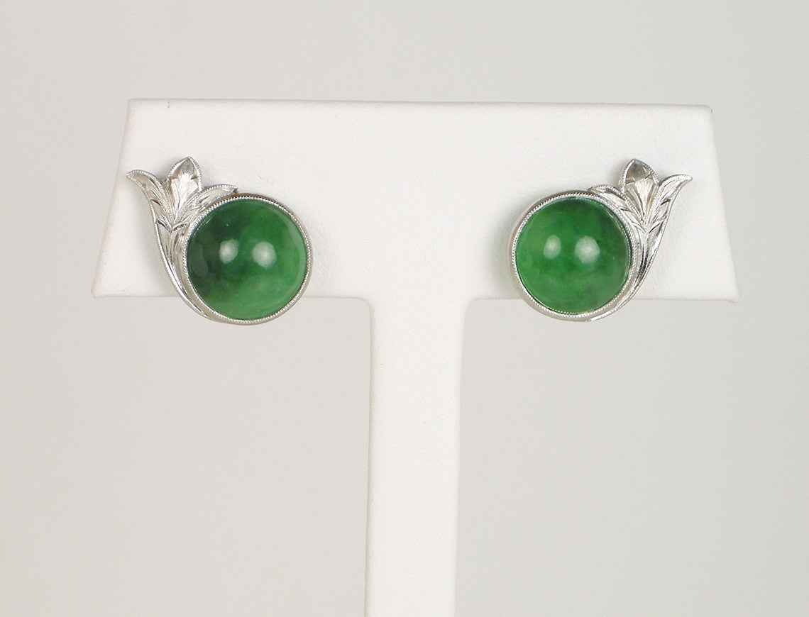 Green jadeite in silver
