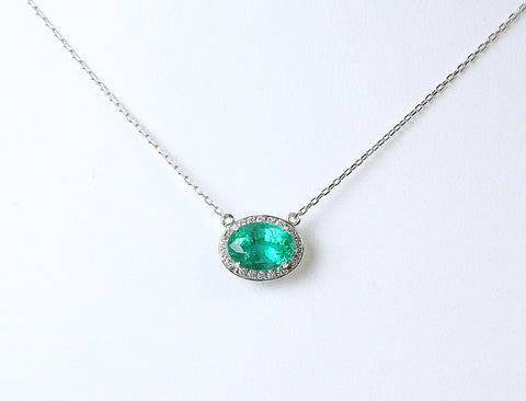 Oval emerald in diamond halo