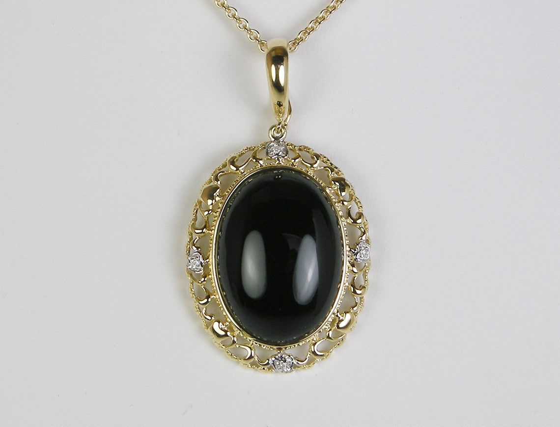 Onyx and gold pendant