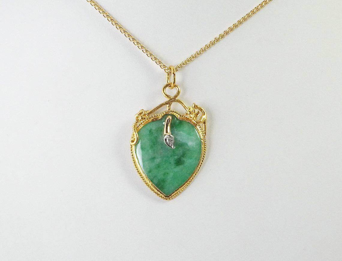 Brilliant green jadeite in 22K gold