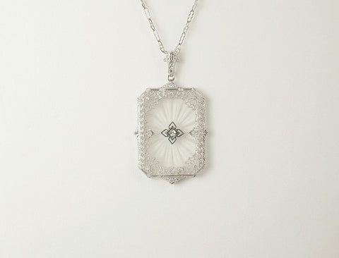Vintage carved crystal and diamond pendant