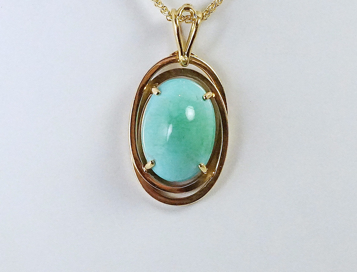 Turquoise cabochon in 18K gold