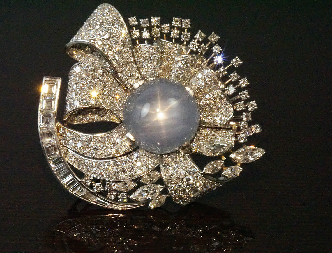 Dramatic mid-century star sapphire and diamond brooch