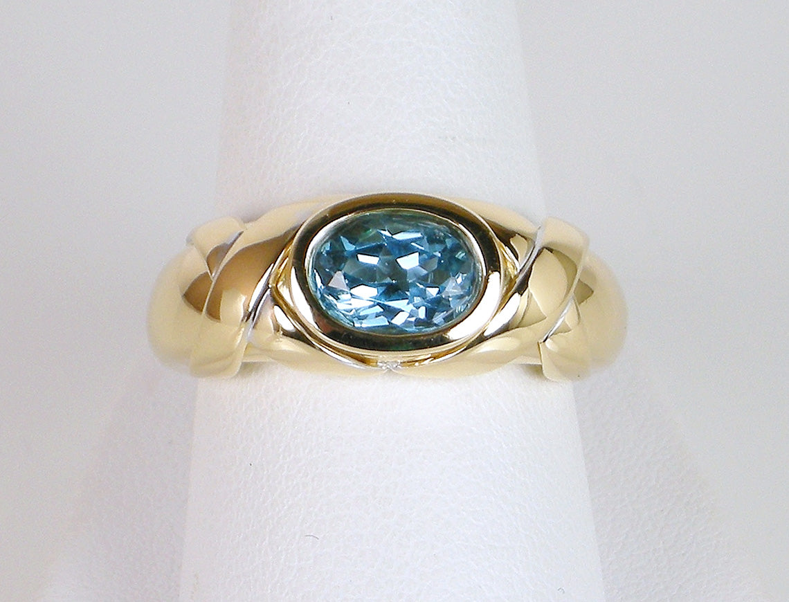 Blue topaz in gold