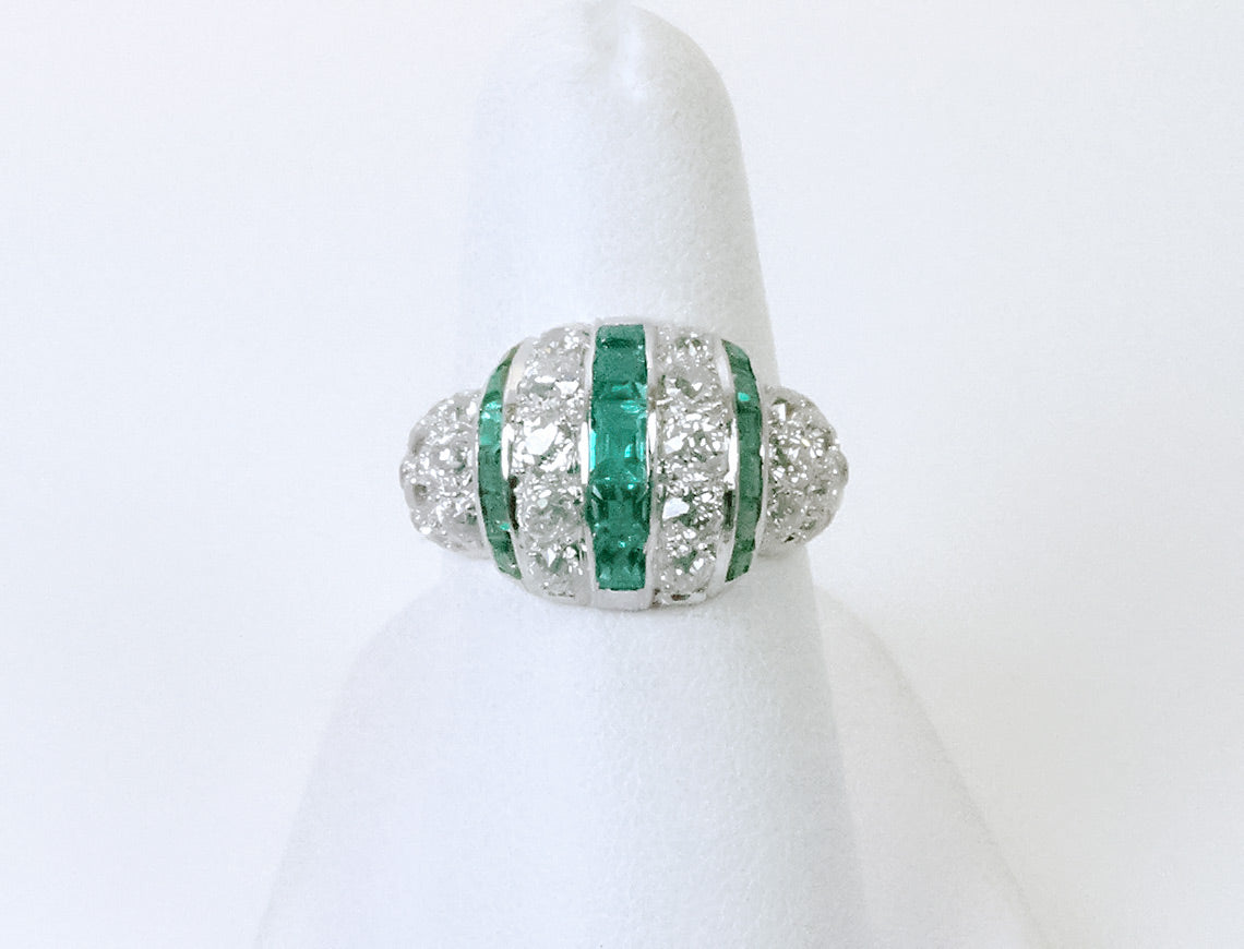 Vintage platinum emeralds and diamonds in Deco ring