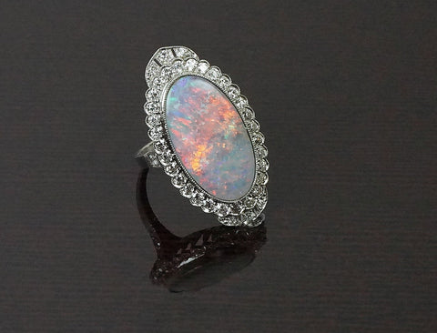 Stunning opal and diamond ring