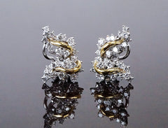 Platinum, 18K and diamond earrings by Oscar Heyman