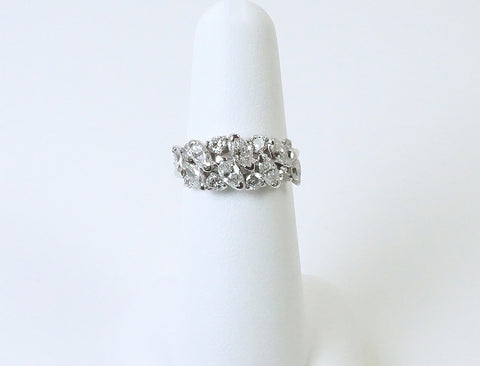Marquise and round diamonds in platinum