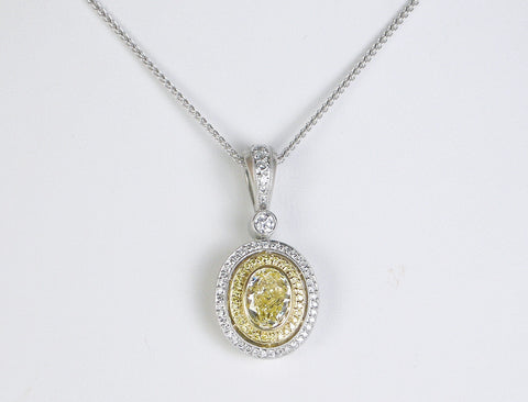 Fancy yellow diamond pendant by Michael Beaudry