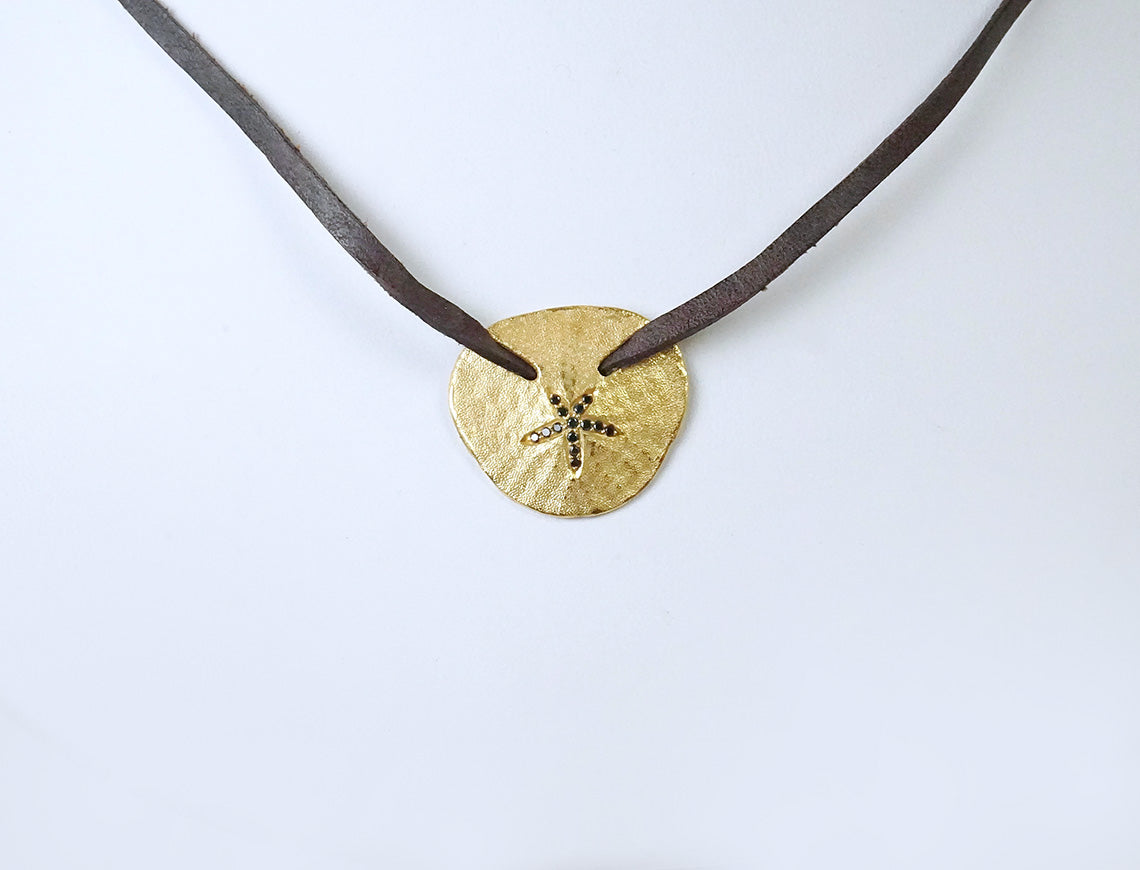 Sand dollar pendant by Carolyn Roumeguare
