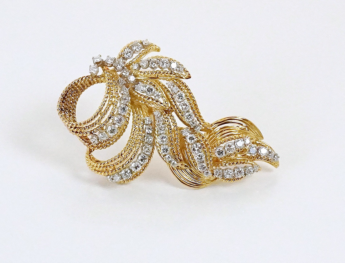 Swirls of diamonds in gold