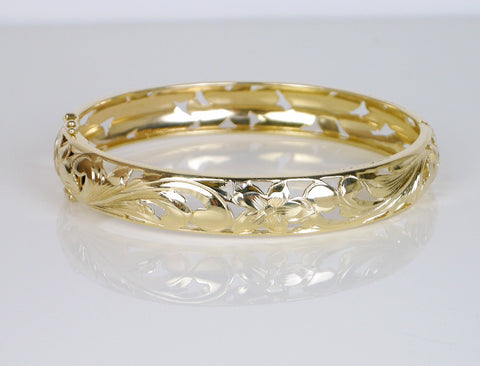 Pierced and engraved hinged bangle
