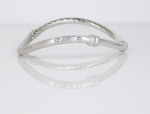 Contoured white gold bangle