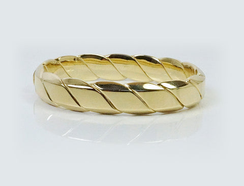 Hinged bangle bracelet of 18K gold