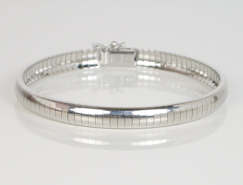 White gold Omega-style soft bangle