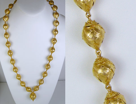 Dramatic gold bead necklace