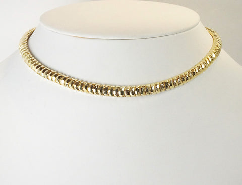Faceted necklace by Henry Dunay