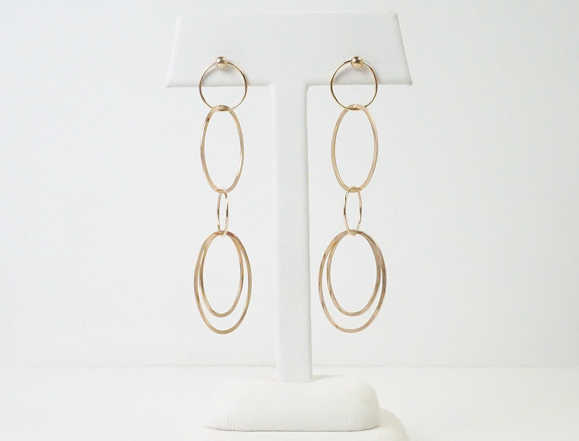 Dancing rose gold earrings