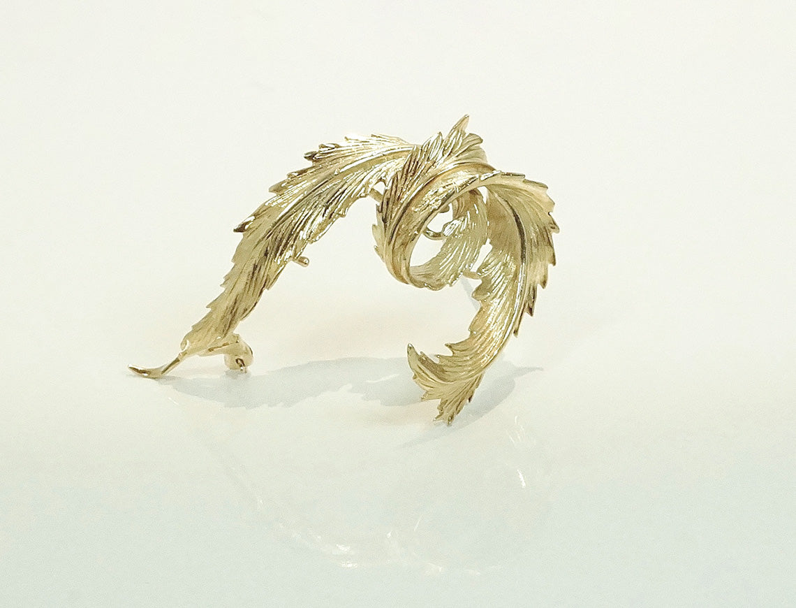 Graceful feather brooch
