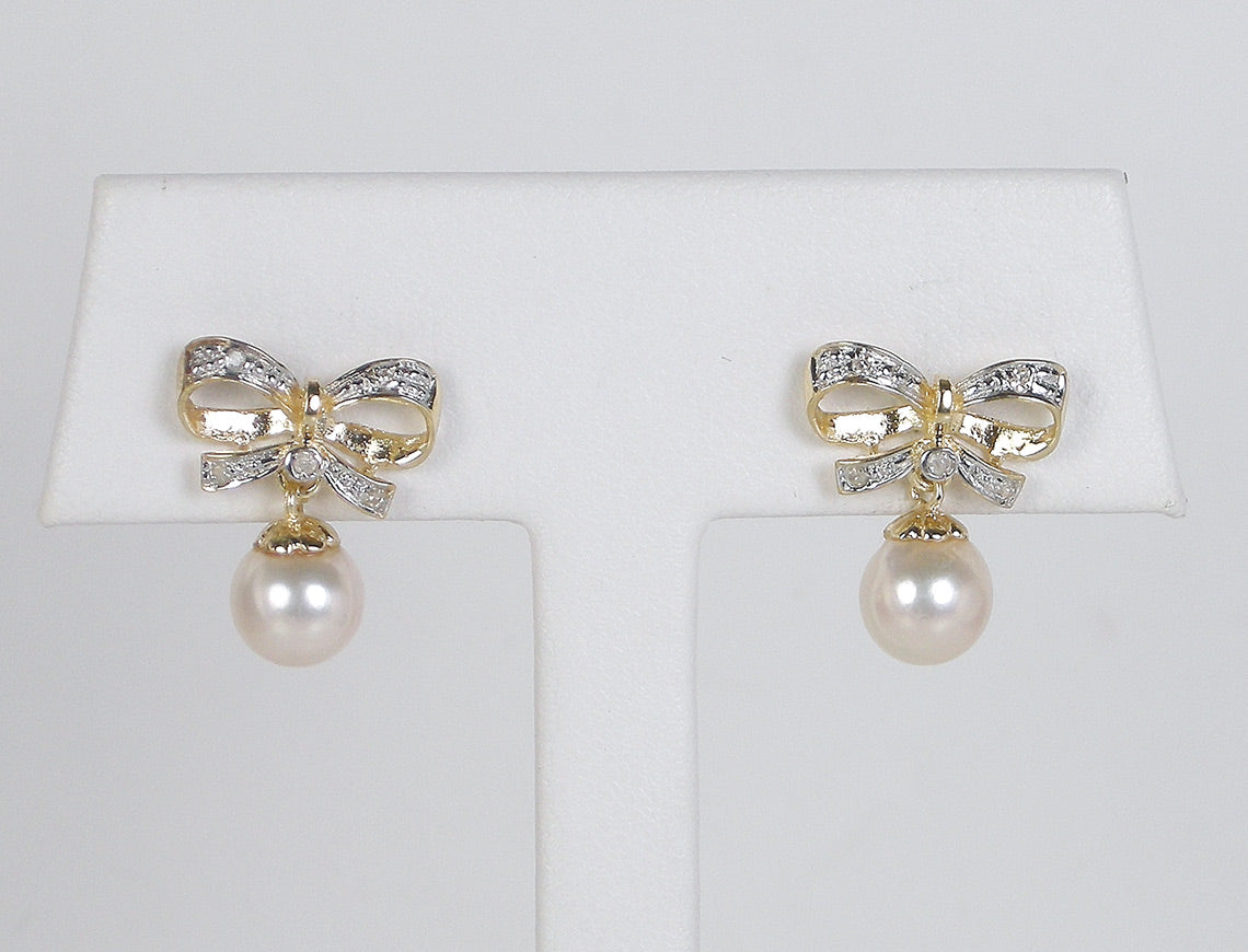 Pearl and diamond bows