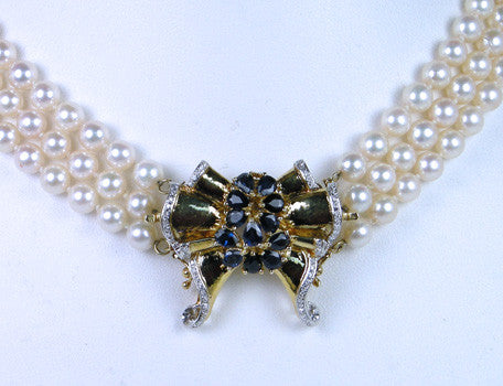 Pearl choker with diamonds and sapphire clasp