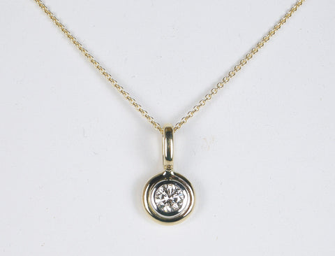 Platinum and 18K diamond pendant