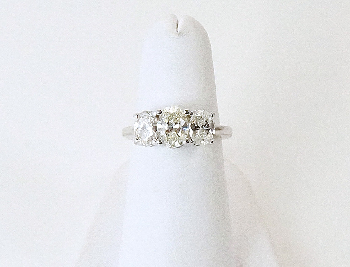 Three-stone oval diamond ring