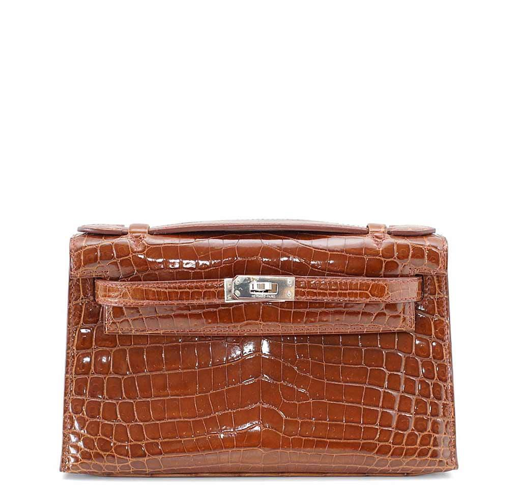 db541ad7d1ee Hermès Kelly Pochette Mini Crocodile Miel Bag
