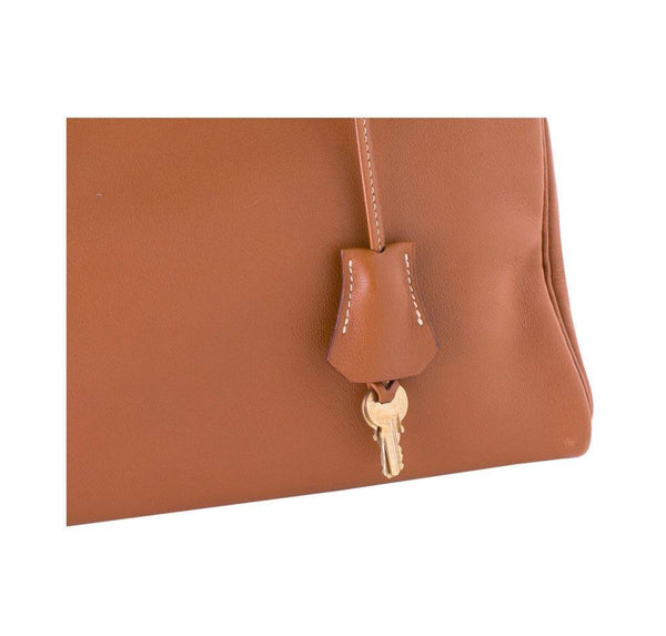 hermes kelly 32 gold used lock