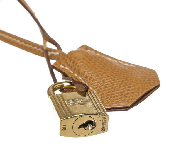hermes kelly 28 gold used lock