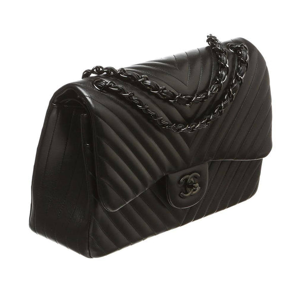 chanel jumbo classic flap bag black used side